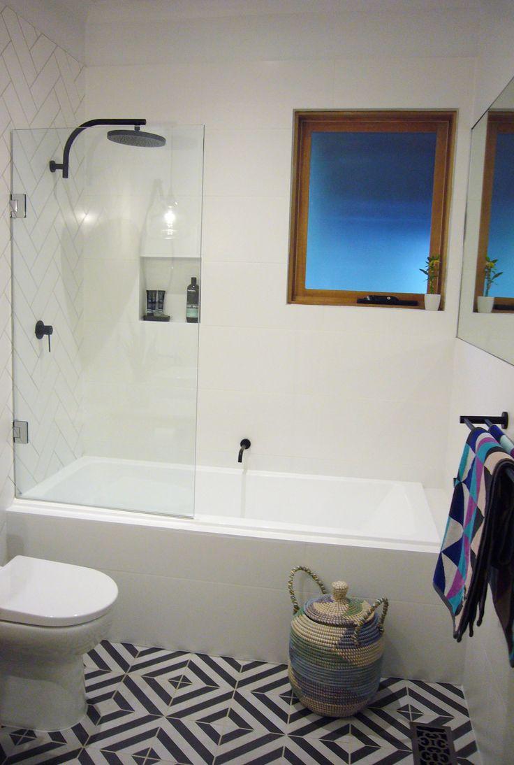 Review Interiors - Bathroom renovation. Geometric tiling, matt black tapware #reviewinteriors # interiordesignmelbourne #interiordesign #bathroomdesign