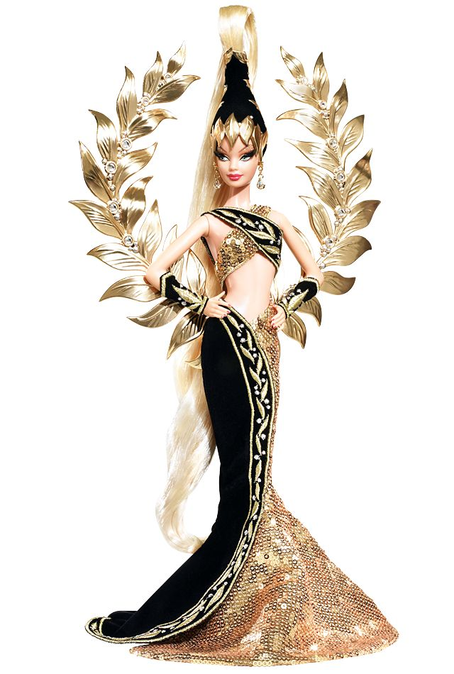 Bob Mackie Golden Legacy™ Barbie®. Bob Mackie lends his superior design sensibilities once again to Barbie®. The results? A gorgeous and glamorous creation in golden sequins and lush black velvet. A true vision from head to toe, this doll is a true celebration of excellence.