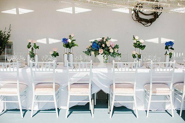 Intimate Weddings Greece | Silver Bottles Centerpiece | Santorini Wedding by Stella and Moscha - Exclusive Greek Island Weddings | Photo by Anna Roussos | www.stellaandmoscha.com