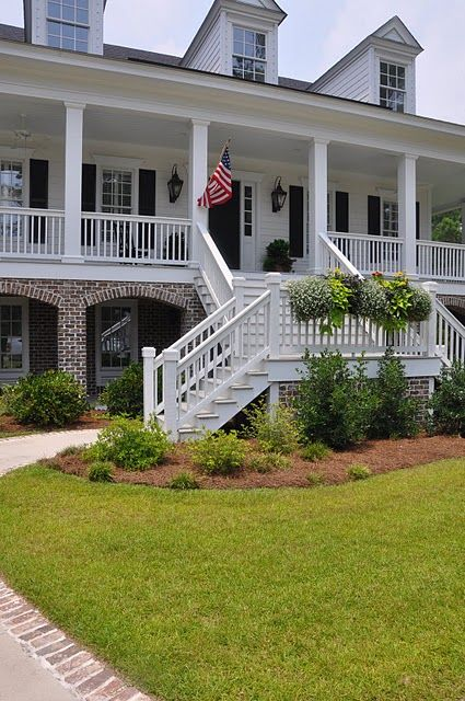 I love the front of this house. Huge front porch with the American Flag.