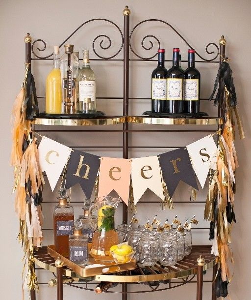 Bar set up for adult birthday party; DIY tassels, Cheers bunting, signature drink, decanters, mason jars, striped straws, black, peach and gold - Ashley Lindzon Events