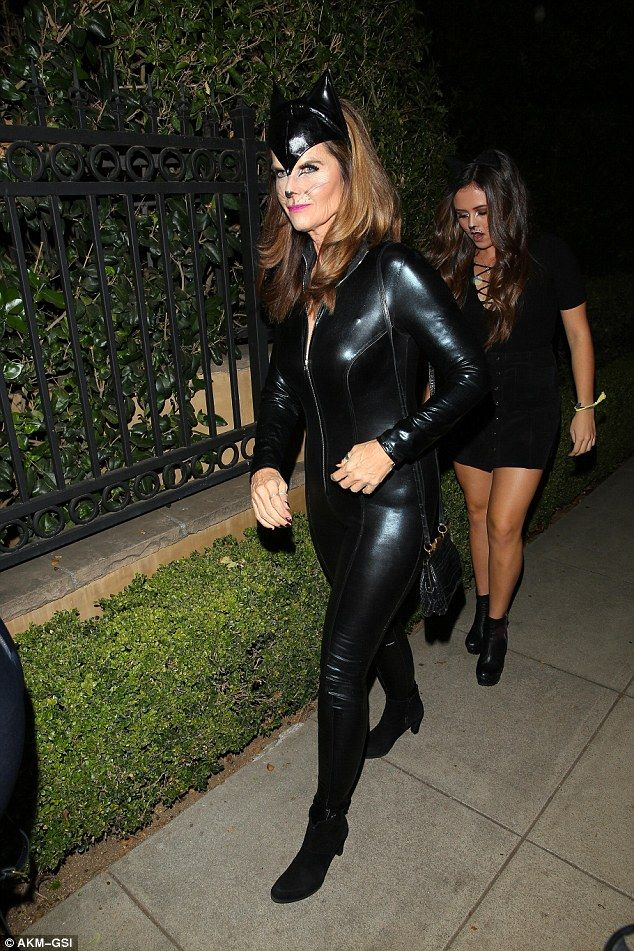 Classic cat: Former first lady of California Maria Shriver was part of that group as well, going with a full length leather Cat Woman suit, that showed off her still svelte figure