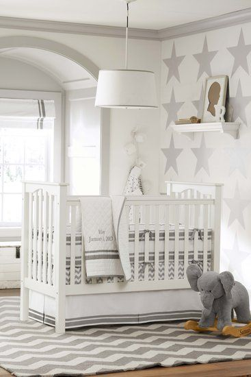 I love the elephant rocker :)... And look at the color! Gray for a baby room? Who knew? love the star wall...