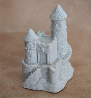 "Winding Stair Fairy Sandcastle. This sandcastle stands 3.75"" tall and is handcrafted from real sand! The white sand is lightly sprinkled with glitter to add a bit of sparkle. Dimensions - 4"" high, 3"" wide and 2.75"" deep"