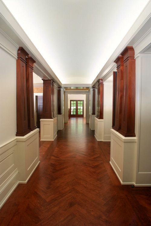 Beautiful, Craftsman-style hardwood flooring It's uncomplicated. It's gorgeous. It's home. Showcasing the elegance of Craftsman style, this hallway features herringbone hardwood flooring in a cherry finish with custom mahogany wood columns.