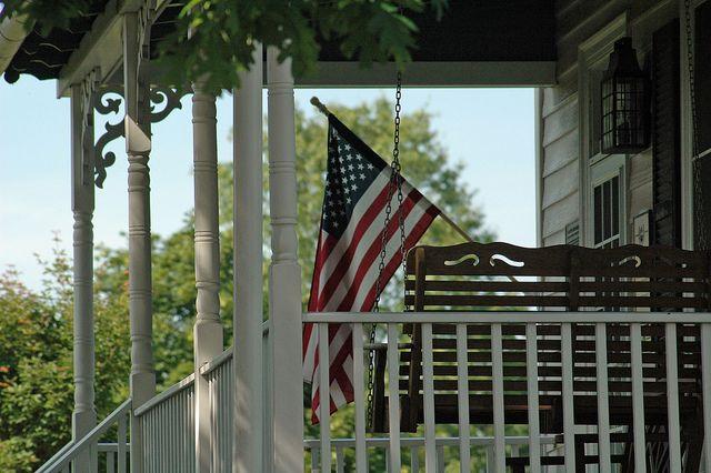Flag on porch of Ida Lee Farmhouse - Leesburg VA by JenniferEatonPhotography, via Flickr