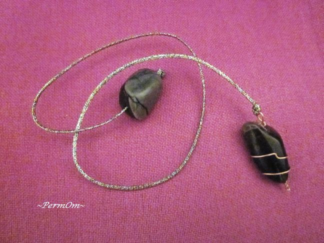 A very beautiful and powerful black smoky quartz pendulum with copper wire and copper hook with a grey /black jasper to the finish that centers one during healing, and can provide a grounded link between the physical and higher selves, helping to uncover subconscious wisdom. Using this smoky quartz pendulum while you ask questions or during channeling enables you to reach higher states of consciousness.