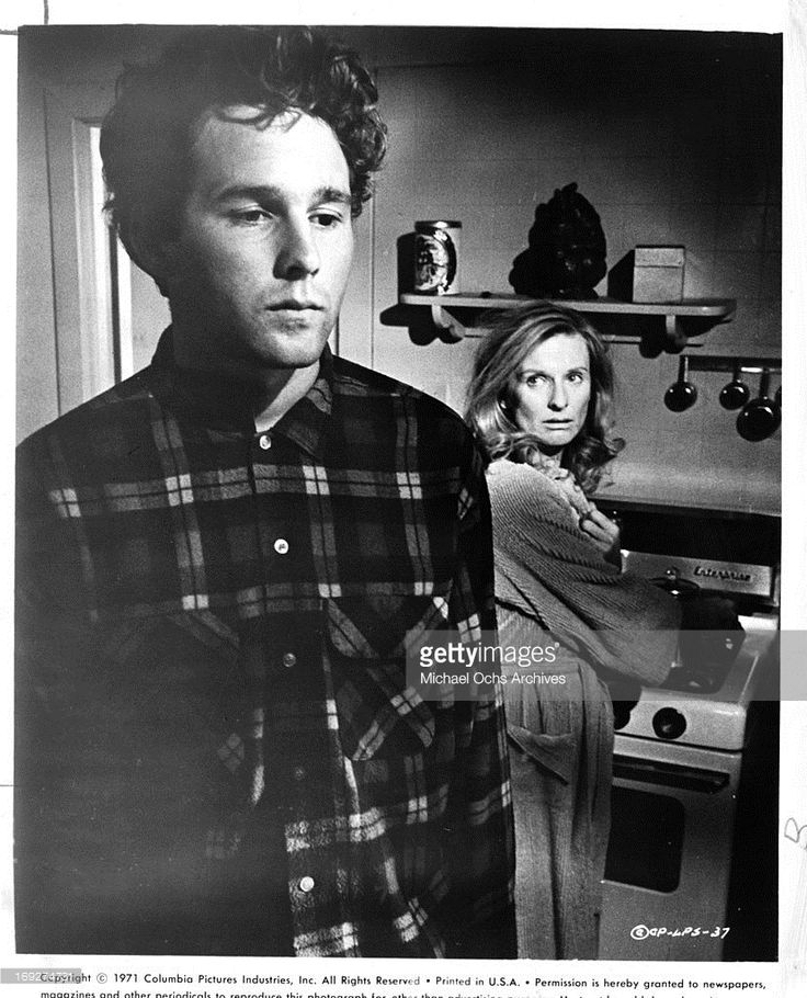 Timothy Bottoms with his back to Cloris Leachman in the kitchen in a scene from the film 'The Last Picture Show', 1971.
