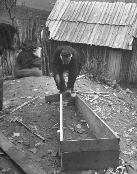 Civil War/Greece  Lt. Col. Georgios Economitas making a coffin.Location:Louzesti, Greece  Date taken:December 1947  Photographer:John Phillips