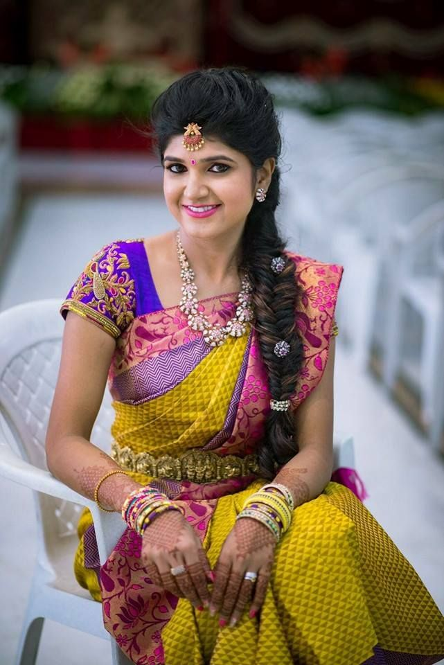 South Indian bride. Gold Indian bridal jewelry.Temple jewelry. Jhumkis.Yellow silk kanchipuram sari.Side fishtail Braid with fresh flowers. Tamil bride. Telugu bride. Kannada bride. Hindu bride. Malayalee bride.Kerala bride.South Indian wedding.