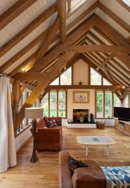 A magnificent barn room with exposed sling-brace oak frame