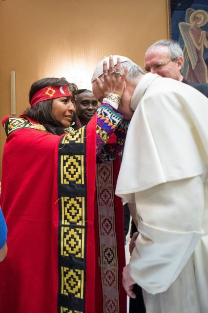Pope Francis is greeted during a meeting with indigenous people to mark the 40th governing council of the the International Fund for Agricultural Development (IFAD) at the Vatican February 15, 2017. Osservatore Romano/Handout via REUTERS