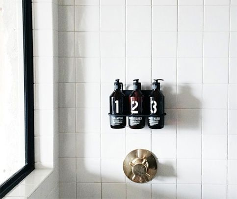 Don't you love those wall-mounted soap and shampoo dispensers in spas and high-end gyms? They make them for home use, too...and they're remarkably easy to install.    - ELLEDecor.com