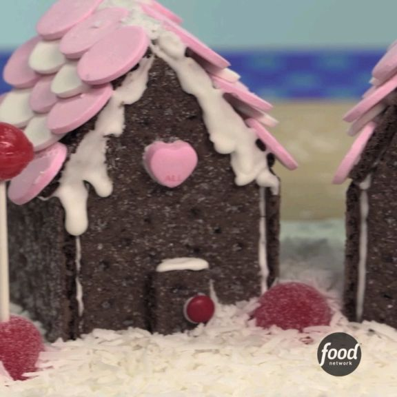 Forget gingerbread! Save time and effort by using store-bought graham crackers to form the base of your festive house.