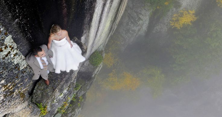 How do you combine your love of adrenaline-pumping adventures with wedding photography? Simple! You get your bride and groom to scale a cliff for the photo