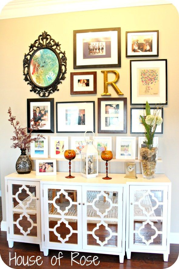 LOVE this art wall! Oliver's famous finger painting would look lovely in that oval IKEA frame!