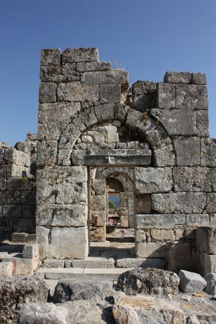 The ruins of a Christian Church in the ancient Lycian city of Kaunos. You can Just make out the cross above the doorway.