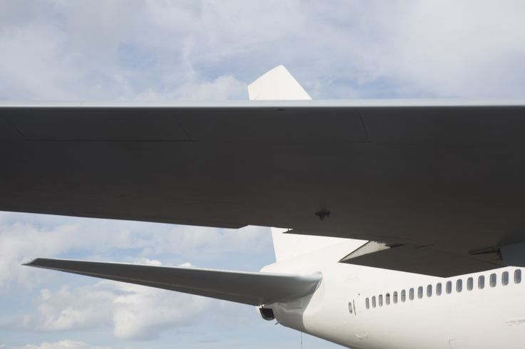 Avalon Airport - I stood slightly near one of the wings of the plane to capture something different. I like how the wing aligns with the windows of the plane.