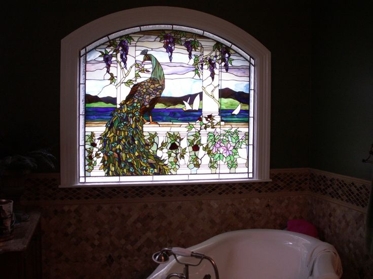 Stained Gl Windows In The Bathroom Allow Light And A Focal Point To E