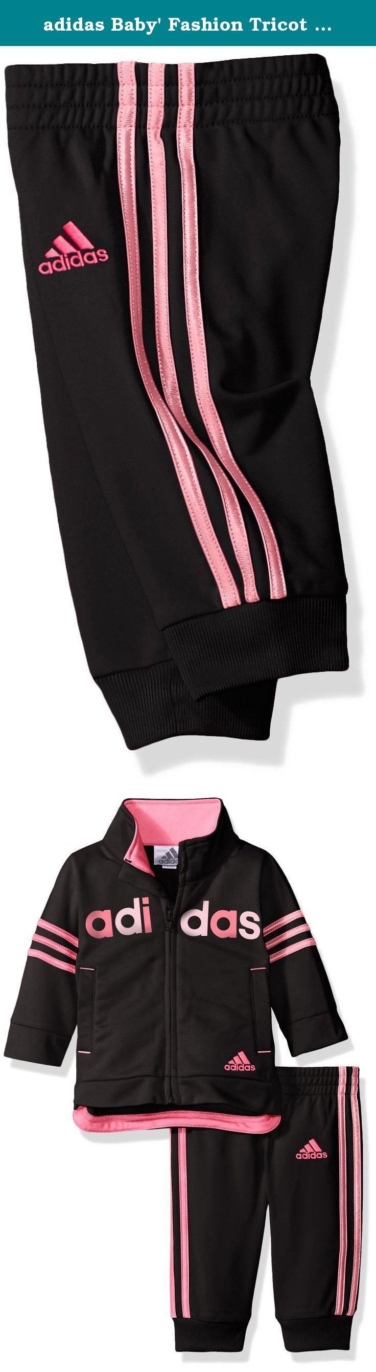 adidas Baby' Fashion Tricot Jacket and Pant Set, Caviar Black, 18 Months. The jogger tricot jacket set features drop shoulder sleeves with dazzle applied stripes on sleeves and welt pockets. Mock neck and drop-tail hem are lined with contrast facing. Adidas linear read screen printed across chest and embroidered Adidas brand mark below left front pocket. Jogger style pant features elastic waistband, bottom rib cuffs and dazzle applied stripes down side seams. Embroidered Adidas brand mark…