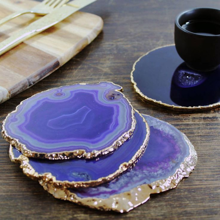 These set of two, completely one of a kind Purple Agate Coasters are the ultimate home decor accessory.Give your dining table the perfect finishing touch with these stunning semi-precious stone slices. They also make ideal gifts for your fabulous friends to sit on their desks or bedside tables. These unique Agate Coasters are sliced, polished, dyed and then coated in 24ct Gold Plating to give a smooth high shine finish that Lustre in any light.Agate Stone & 24ct Gold Plating. Due to the ...