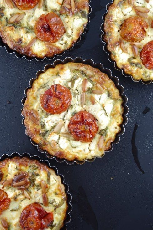 This roasted cherry tomato, feta, rocket (arugula) and pine nut quiche from Jamie of lifesafeast.net is bursting with summery goodness.