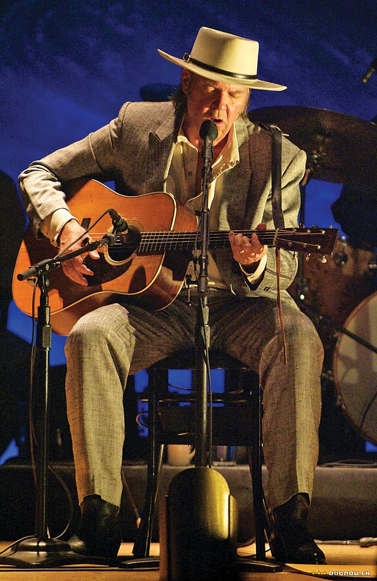 Neil Young. He is playing Hank Williams Sr.'s Martin D28. He wrote Old Man on that guitar.