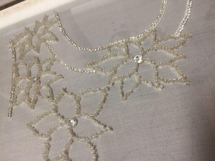 Silver/white luneville embroiderd dress. www.janvanderheijdenjr.nl