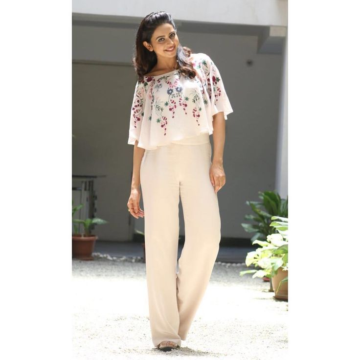 "@shriyasom) on Instagram: ""@rakulpreetofficial in our onion pink cape top and nude pallazo pants for #sarainodu success meet…"""
