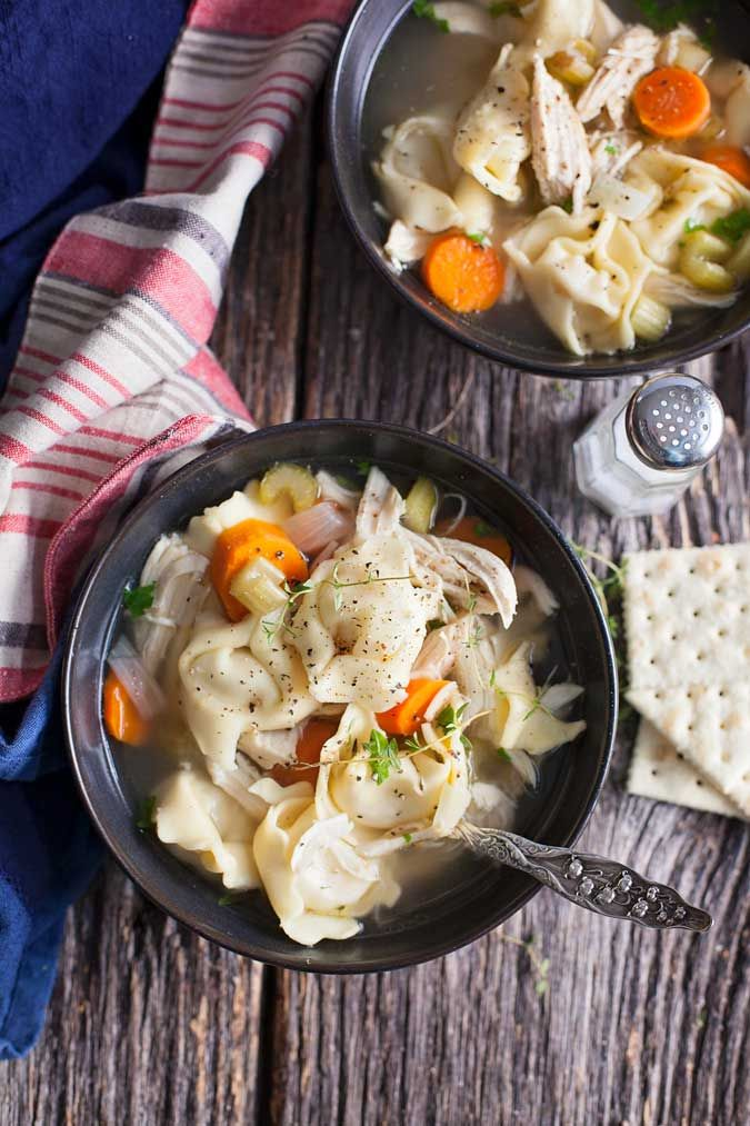 Slow cooker chicken tortellini soup is a hit at our house! Easy to make and hearty for cold, busy nights.