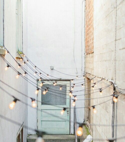 no matter what your backyard (or alley!) a string of lights always elevates the mood!