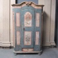 Armoires/Cupboards - An antique painted pine armoire made for a marriage in the early 19th century. Superb original condition. Lovely colour.Baroque neo-classical details. The central upper panel shows christ in heaven, surrounded by a mandorla, and below a bird in a tree. The long neck, beady eye and colouration indicate that this is a turtle dove. The detail is not merely incidental or decorative as the turtle dove was a commonplace folklore and religious symbol that would be understood…