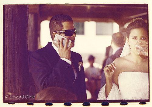 Groom on phone and bride on white wine - Edward Olive European destination wedding photographer
