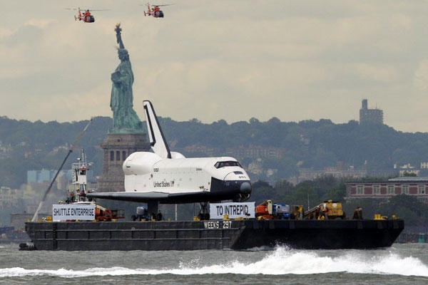 The space shuttle Enterprise, a prototype which never flew in space, travels up the Hudson River by barge to it's new home aboard the Intrepid Sea, Air and Space Museum on June 6, in New York.    Kathy Willens/AP
