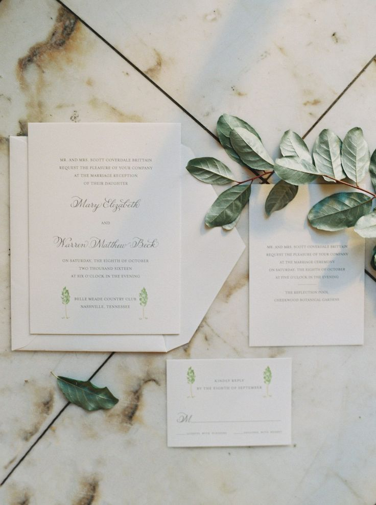 The invitations, by Emily Holmes, captured the simple elegance of the wedding. See more photos from this stunning garden wedding at styleblueprint.com! Image: Cassidy Carson Photography  Invitations: Emily Holmes