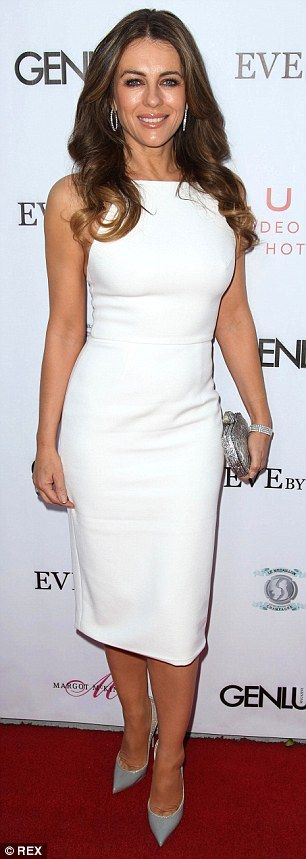 Almost fifty and fine! The 49-year-old actress showed off her sculpted upper back and calv...