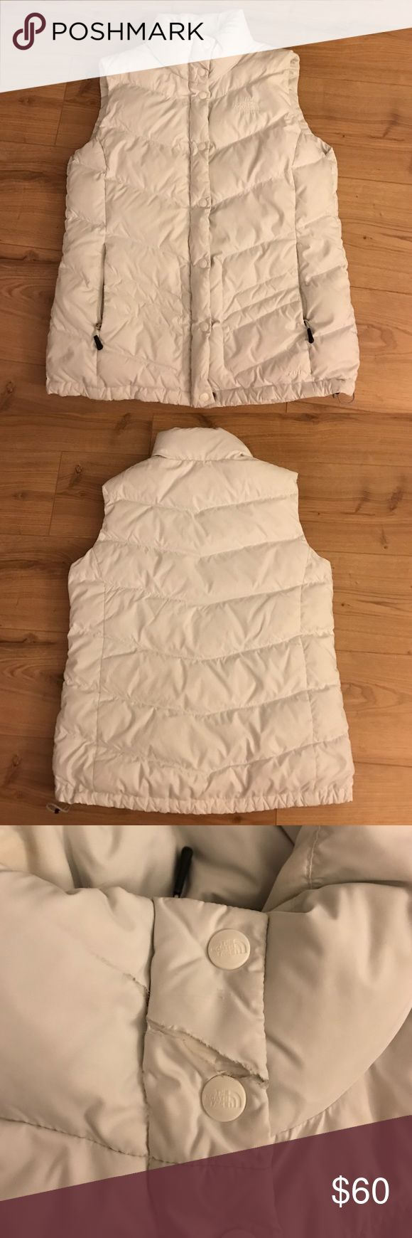 Women's North Face Nuptse down vest White down winter vest by Northface!! One of my favorite must haves! Vest no longer fits me. There is a small deformity/ tear near the top button which is shown in one of the pictures, otherwise in great condition. North Face Jackets & Coats Vests