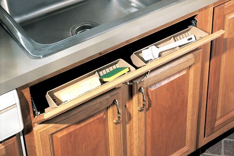Kitchen scrub brushes, and sponges can leave #messy build-up above the #faucet. Using the space just above your sink cabinet can provide a #solution to this. The #Merillat Masterpiece Utensil Tray Kit makes use of wasted storage area #under the #sink. Great for scrubbers and sponges that you want to keep within reach but out of sight. #Trays are removable for #easy #cleaning. #Kitchen #Storage