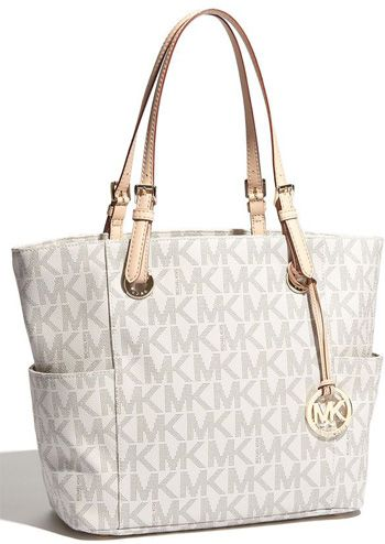 PINTEREST is TRYING to make me kick myself for not buying one of the MK purses in Hotlanta I guess, THEY KEEP POPPING UP on me!!
