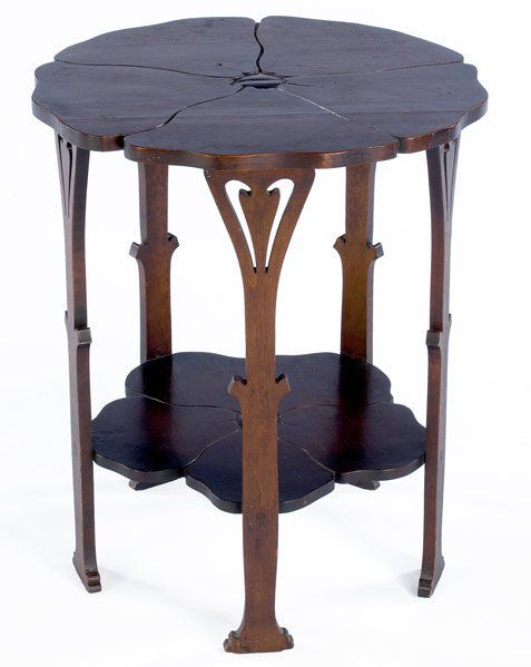 "GUSTAV STICKLEY: Early maple Poppy table (no. 26), with carved floriform top, lower shelf, and legs, ca. 1900. Fine original finish, professional restoration to chip on one foot. Unsigned. 23 1/2"" x 20"""