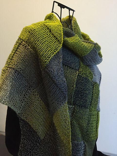 Entrelac is a wondrous technique. It cannot easily be machine produced and it is beautiful to watch a slowly variegated yarn transform as the entrelac fabric grows. Christine ventures past the typical rectangular Entrelac shape to achieve a light shawlette that could be worn year-round.