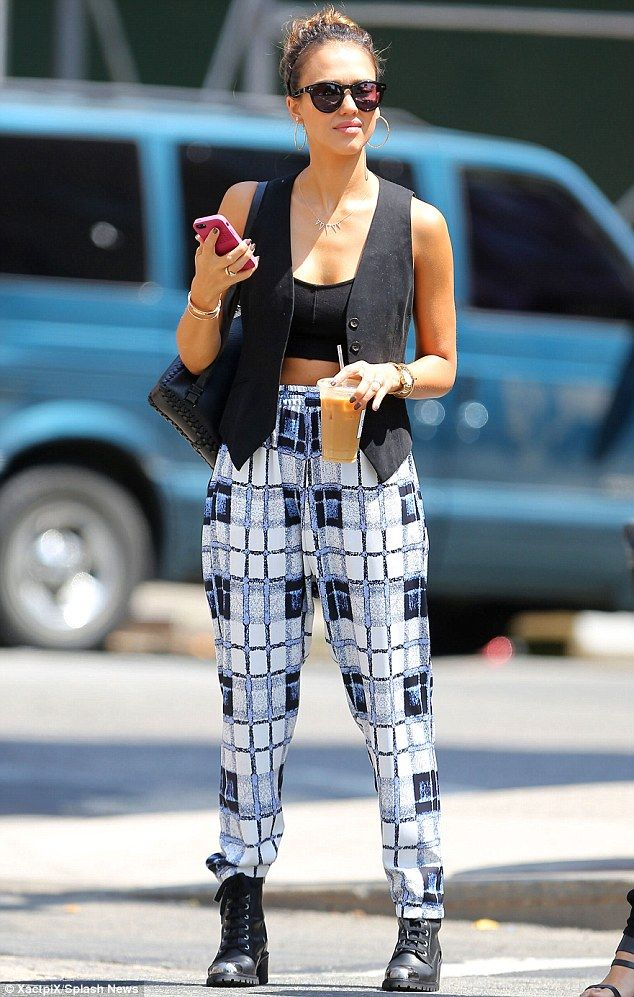 Jessica Alba - blue, black and white parachute pants with a black crop top and black waistcoat
