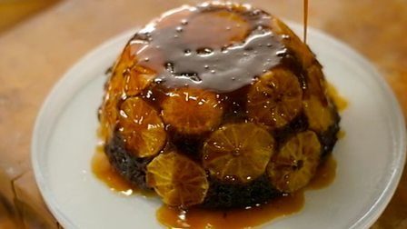 Steamed chocolate and clementine sponge with orange sauce