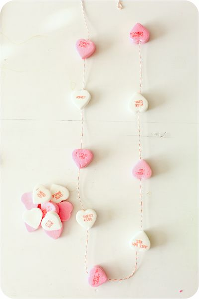 Grab yourself some twine, candy hearts and a hot glue gun….and glue the larger hearts back to back every 6-10 inches= very easy decor for a table or chandelier or class party.