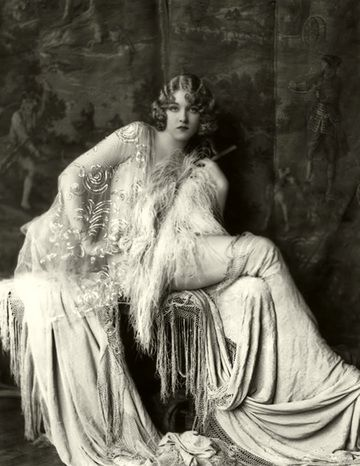 Ziegfeld girl in a costume by Erte. The Ziegfeld Follies were a series of elaborate theatrical productions on Broadway in New York City from 1907 through 1931.
