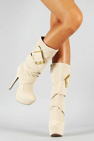 White Platform High Heel Boots. Like how high they come up. It would be cute with a shorter like dress in the winter.