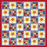 """Week21: 'My Flower Garden' a quilt design I created using two different blocks. The first is a simple 16 patch block where each piece within it is the same size and the other block is a simple flower applique block. I have kept the background fabric of this block very light and the applique flower nice and bright.    The finished size of this quilt makes it an ideal throw quilt. To make it suitable for a bed quilt you would need to add 2 extra rows bringing the finished size to 65"""" x 85""""."""