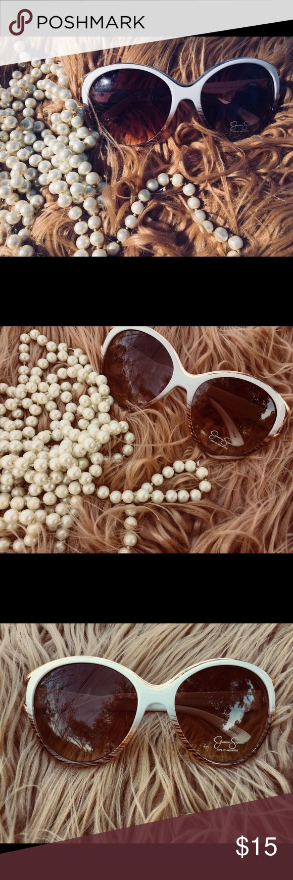 NWT- Beautiful Jessica Simpson sunglasses Lenses are pretty dark and the frames are white and brown. These are a great staple piece and look good on any facial type! Jessica Simpson Accessories Glasses