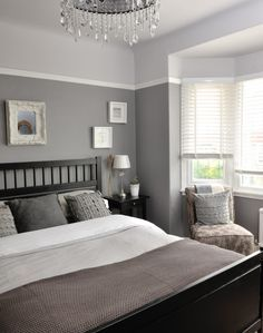 Different tones of grey give this bedroom a unique and interesting look. Continue a colour theme throughout soft furnishings for a boutique-hotel feel