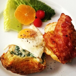 ... brunch today - Gruyere cheese popover with creamed spinach and eggs